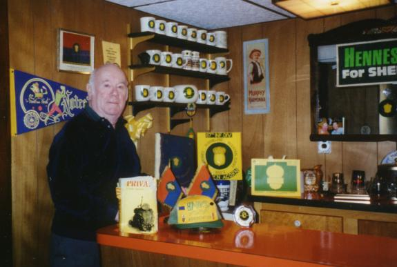 Here's Jim in his recreation room. Judging by the extensive mug collection, he's been to a lot of reunions!