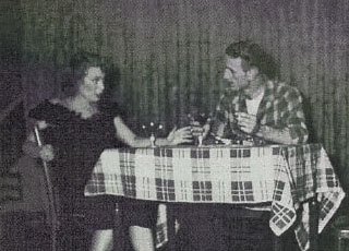 """""""I Live From Day to Day"""" is set in a bar in Cannes. Faye Sperling played Jeannette Ferrand and John Booker Jeff Stevenson in the University of Alabama in Birmingham's Town and Gown Theatre premiere at the Tutwiler Hotel."""
