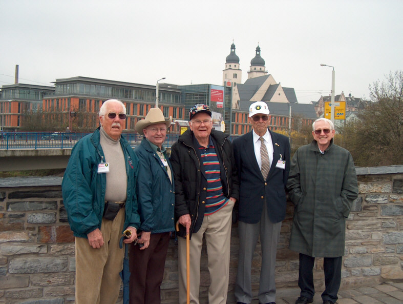 Veterans of 87th Infantry Division on Stony Elsterbridge in Plauen. From left to right: Jesse Bowman, Eldon Gracy, Tom Stafford, Tom Burgess, Gene Garrison